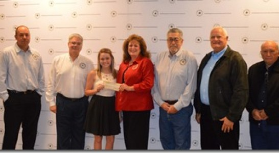 EMCID Presents Scholarship Checks to Internship Students