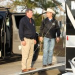 Constable Hayden shows Commissioner Rinehart the Mobile Command Unit in action.