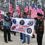 Cpl. Michael Rachal receives a banner signed by PGR members.