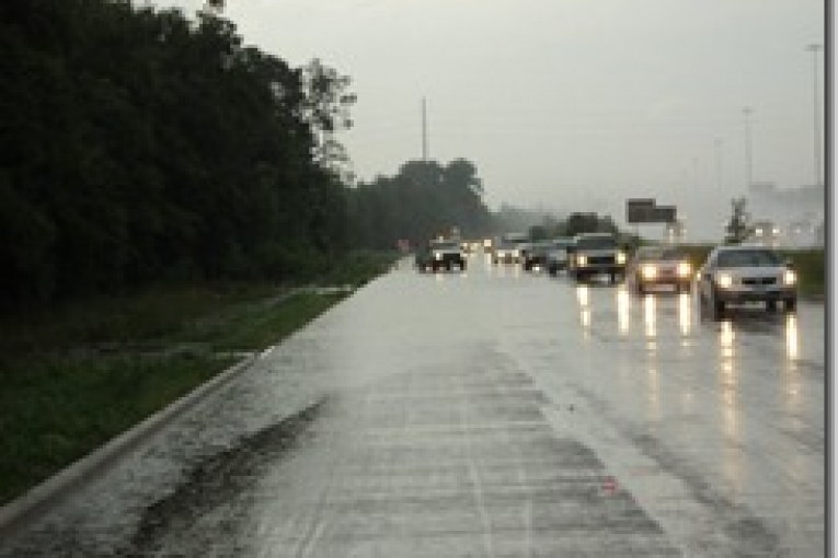 AFTERNOON RAIN BRINGS FLOODING AND ACCIDENTS