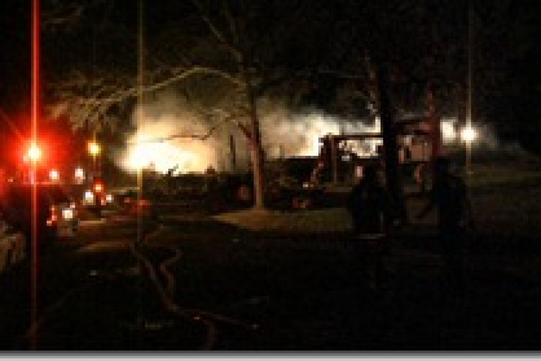 TWO ALARM FIRE DESTROYS MOBILE HOME