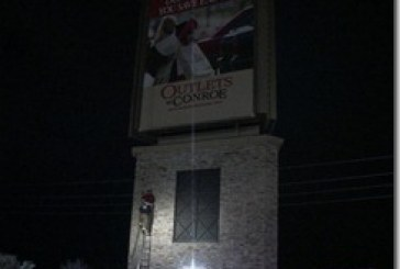 SANTA RESCUED FROM OUTLET MALL SIGN