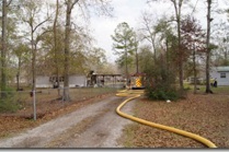 FIREFIGHTERS QUICKLY STOP MOBILE HOME FIRE