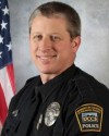 COLORADO POLICE OFFICER DIES AS HE ENTERS CLINIC