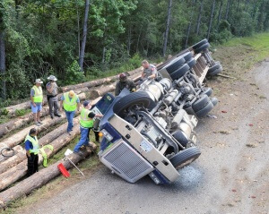 An 18 wheeler logging truck, driven by 32 year old Alan Johnson, of Livingston, turned over on FM-943.