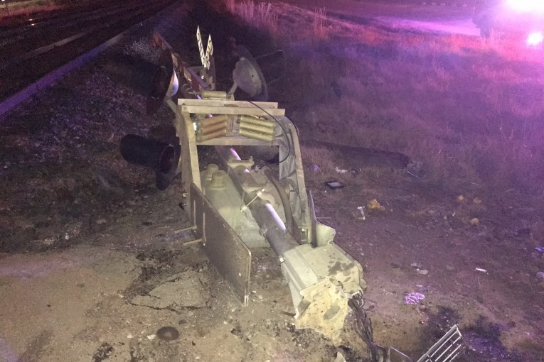 DRIVER WITH SUSPENDED LICENSE HIT RAILROAD CROSSING