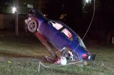 CRASH PUTS CAR ON UTILITY POLE