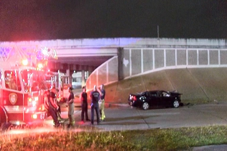 CAR CRASH ON I-45 CAUSES VEHICLE TO DROP 20 FEET DOWN TO INTERSECTION KILLING THE DRIVER