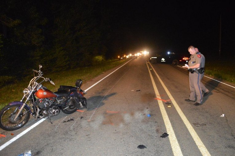 WOMAN DIES AFTER MOTORCYCLE STRIKES DEER