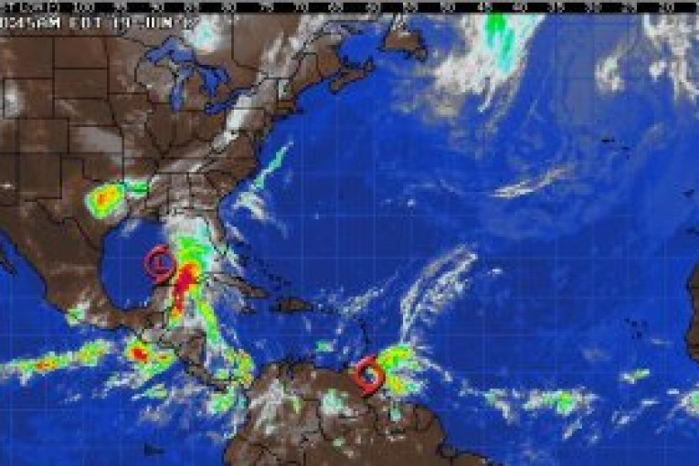 Tropical Storm Bret forms northeast of Venezuela; Potential Tropical Cyclone Three develops in the central Gulf of Mexico