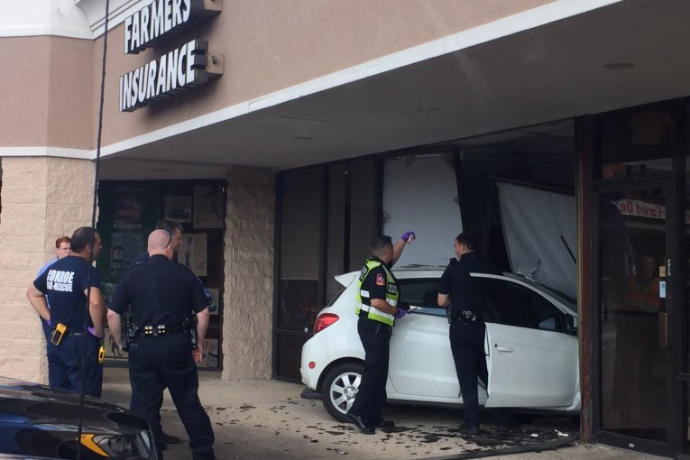 CAR DRIVES INTO FARMERS INSURANCE