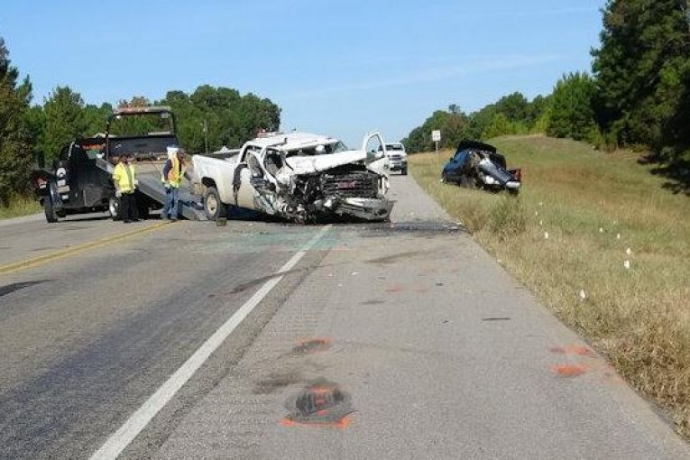 CRASH KILLS ONE , INJURES ANOTHER AS THEY WORK ON DISABLED VEHICLE