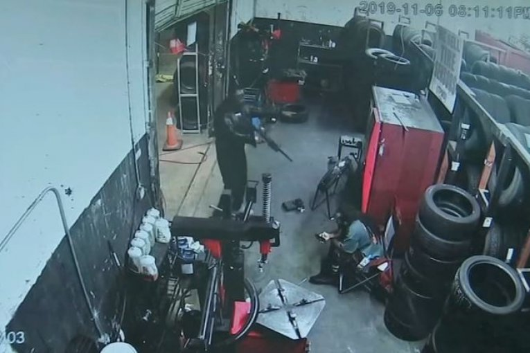 Workers' moments of terror when gunmen storm a Houston tire shop