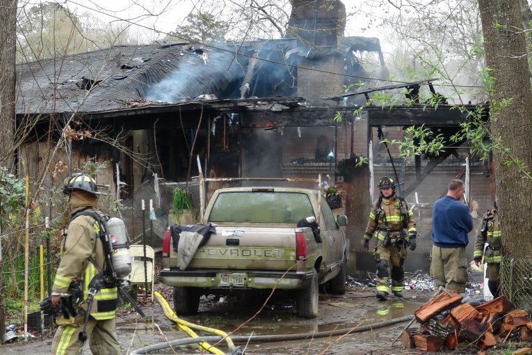 FIREFIGHTERS ENTER BURNING STRUCTURE IN ATTEMPT TO SAVE RESIDENT