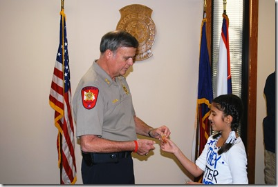Chief_Deputy_McDaniel_presenting_Savannah_with_a_challenge_coin