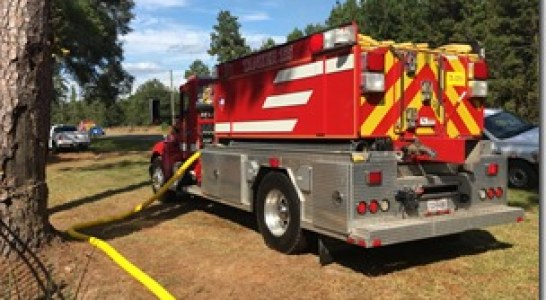 FIREFIGHTERS BATTLE WOODS FIRE