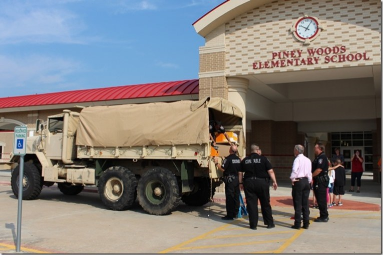 SCHOOL SUPPLIES DELIVERED BY JUDGE AND CONSTABLE