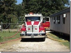 NEW CANEY TRASH FIRE CAUSES TRAVEL TRAILER HOME TO BURN