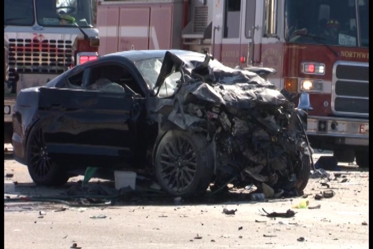 TWO DEAD IN RACING CRASH SEVERAL OTHERS INJURED