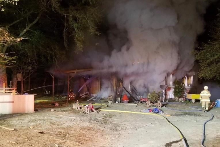 FIRE DESTROYS MOBILE HOME