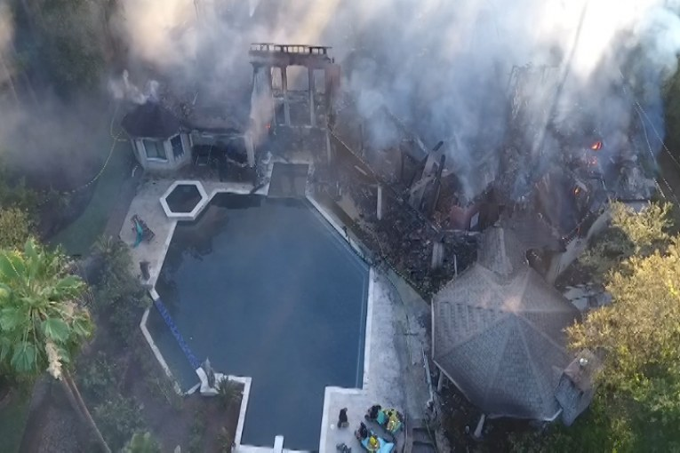 PETS MISSING IN MASSIVE WOODLANDS HOUSE FIRE