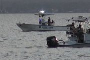 SEARCH CONTINUES FOR BODIES ON LAKE CONROE